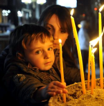 Child lighting candles